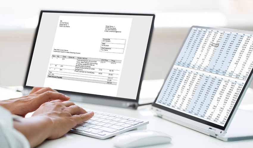 two laptops with invoice and spreadsheet documents open