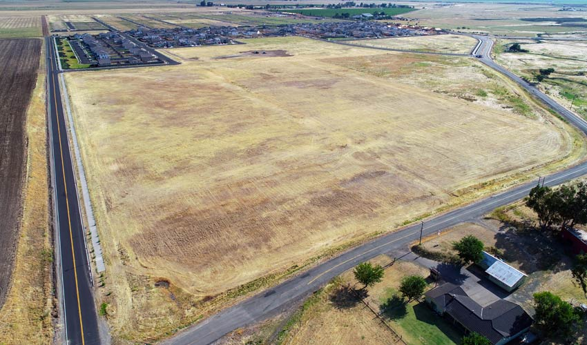 wide aerial view of raw plot of land