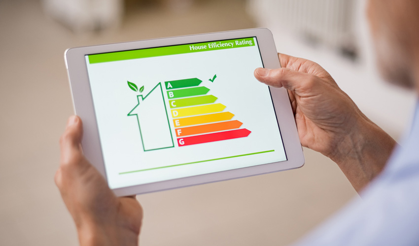 man holding tablet showing home energy rating system app