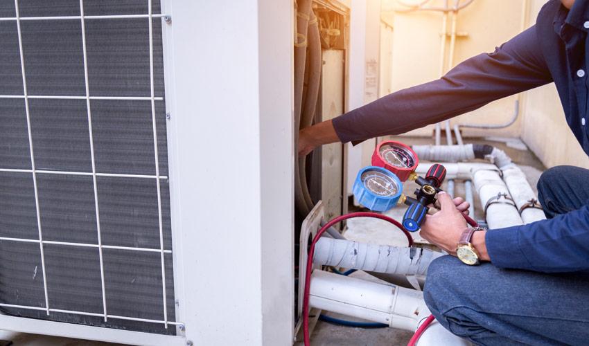 inspector reading meter to determine home energy efficiency rating