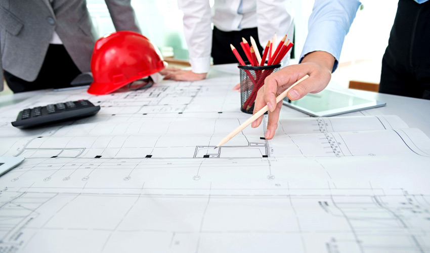 construction documents on a table being reviewed