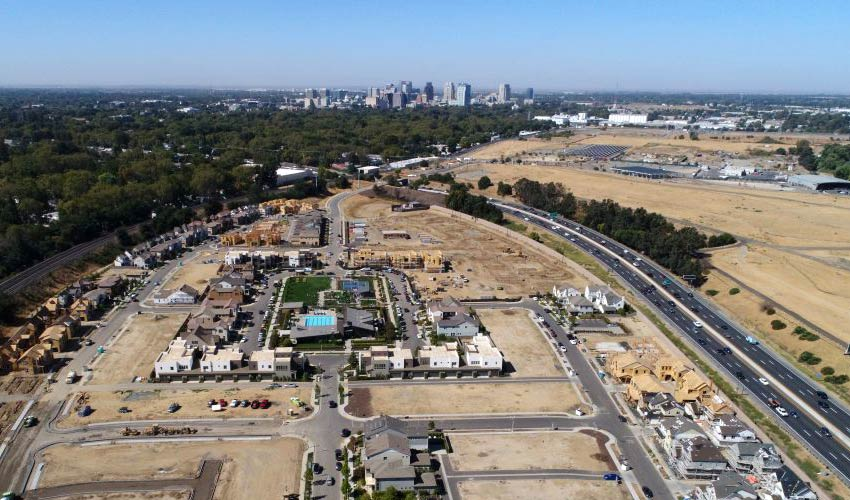 wide aerial view of new development under construction